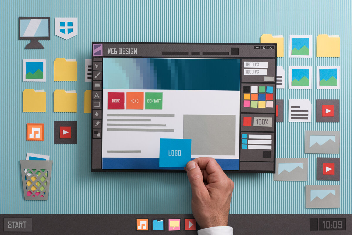 Web designer drafting web templates and web page layouts using a professional software