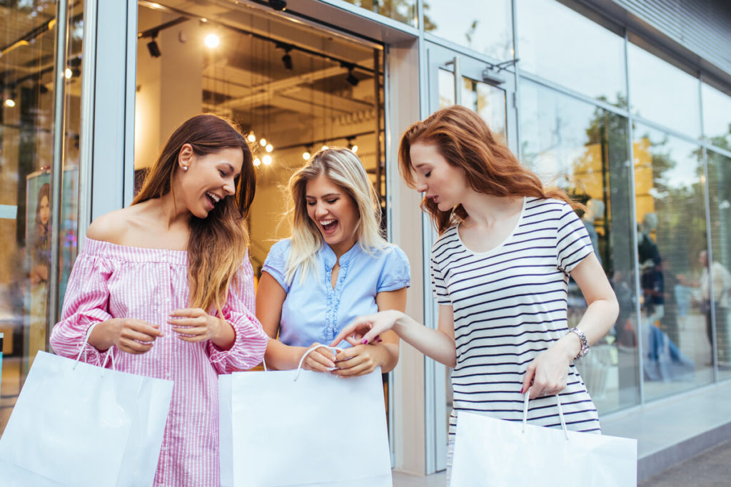 business strategies - friends enjoying retail therapy